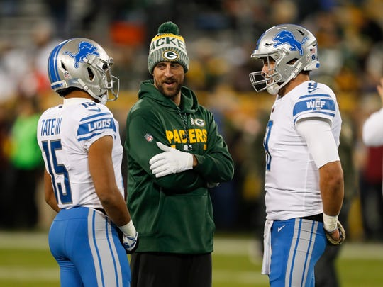 Packers' Aaron Rodgers talks to the Lions' Golden Tate, left, and Matthew Stafford before the game Monday, Nov. 6, 2017 in Green Bay.