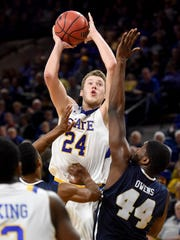 SDSU's Mike Daum goes up for a shot over Oral Roberts'