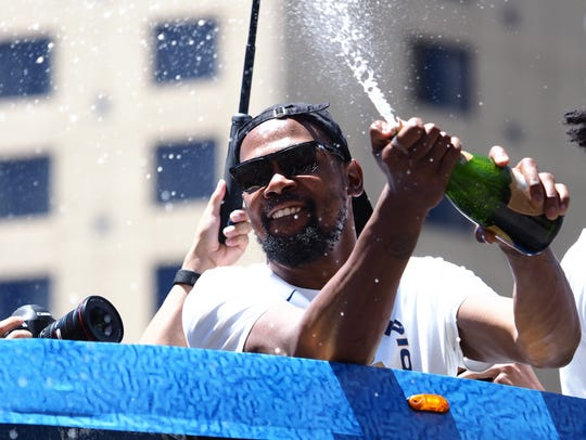 Kevin Durant sprays champagne during the Golden State