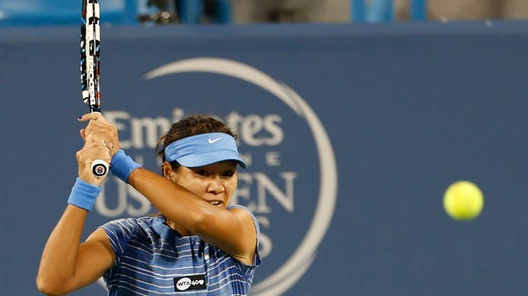 Li Na returns a shot during a match at the Western & Southern Open in August of 2013.