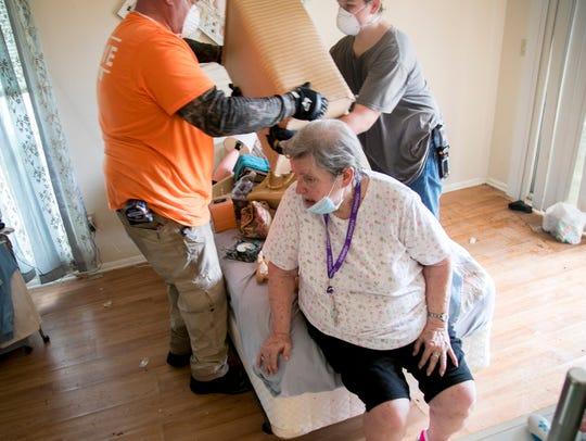 Jan Erickson directs Next Level Church volunteers John