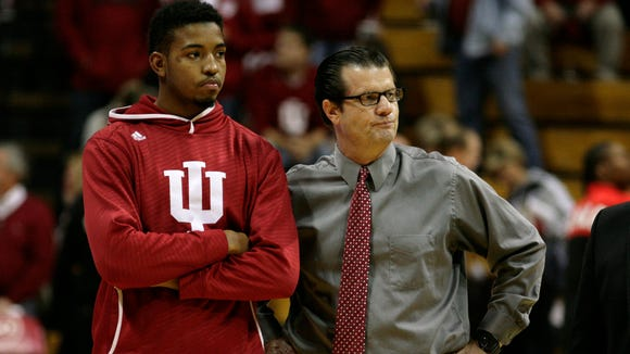 Devin Davis, pictured left next to IU associate head coach Tim Buckley, is working out with his father.