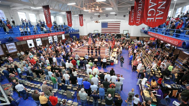 The American Flag is presented during the National Anthem at the start of the Indiana Golden Gloves held at the Tyndall Armory in Indianapolis on Thursday, April 16, 2015.