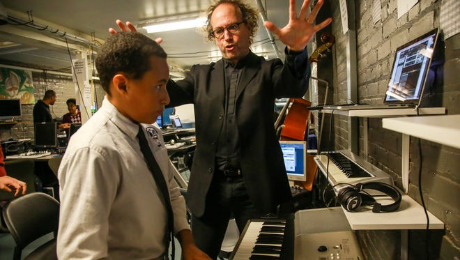 "Tod Machover, composer and professor at Massachusetts Institute of Technology, right, works with Matthew Calvert, 12, of Detroit at the Youthville beat-making lab in Detroit to create music for the upcoming ""Symphony in D"" performance."