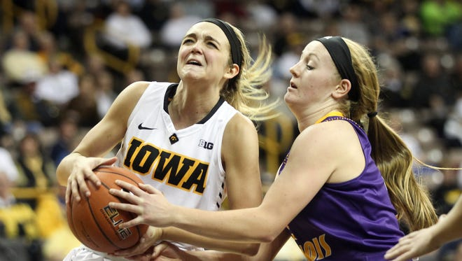 Iowa's Ally Disterhoft draws a foul during the Hawkeyes' game against Western Illinois at Carver-Hawkeye Arena on Thursday, Nov. 19, 2015.