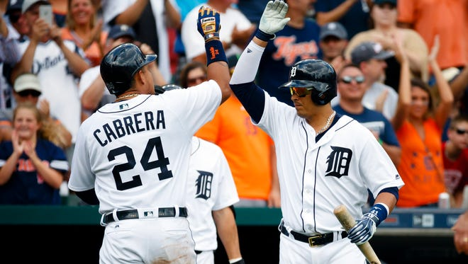 Jul 31, 2016; Detroit, MI, USA; Detroit Tigers first baseman Miguel Cabrera receives congratulations from designated hitter Victor Martinez after he hits a home run in the fifth inning against the Houston Astros at Comerica Park.