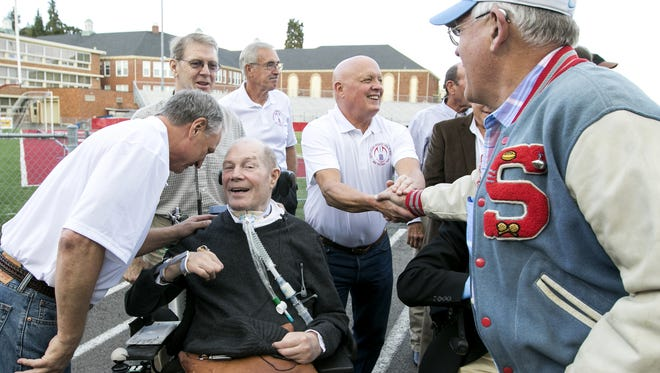 Don Moritz leans in to talk to Lee Watson and Alan Holmer leans in to shake Sonny Jepson's hand as members of the 1966 South Salem High School football team reunite for the 50th anniversary on Friday, Sept. 30, 2016. Watson, the team's co-captain, was inducted into the South Salem Athletic Hall of Fame.