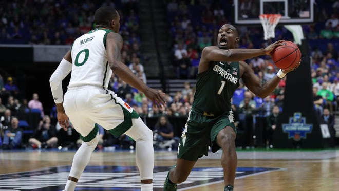 Mar 17, 2017; Tulsa, OK, USA; Michigan State Spartans guard Joshua Langford looks to pass around Miami Hurricanes guard Ja'Quan Newton during the first half in the first round of the 2017 NCAA tournament at BOK Center.