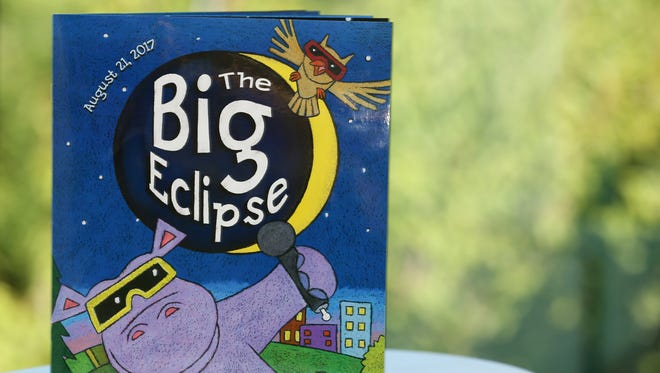 """""""The Big Eclipse"""", a children's book by Nancy Coffelt, explains the August 21, 2017 solar eclipse and gives fun facts on eclipses. Photographed at the Statesman Journal in Salem on Thursday, July 27, 2017."""