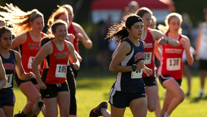 Kennedy's Kaylin Cantu leads the pack at the start of the 3A/2A/1A-SD2 District 2 girls cross country championships at Bush's Pasture Park in Salem on Friday, Oct. 27, 2017. Cantu won the race.