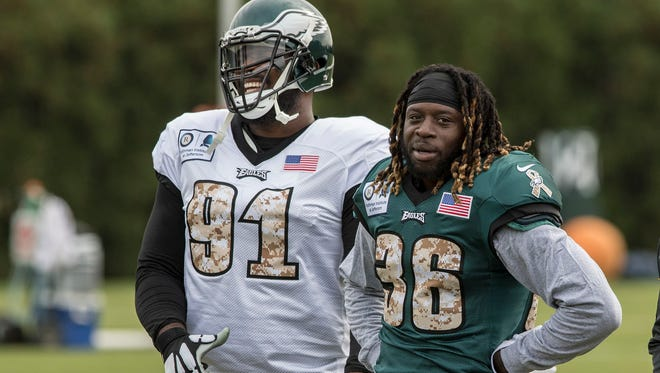 Philadelphia Eagles defensive tackle Fletcher Cox (91) has a laugh with newly acquired Eagles running back Jay Ajayi during his first practice with the Eagles, Wednesday, Nov. 1, 2017 in Philadelphia.