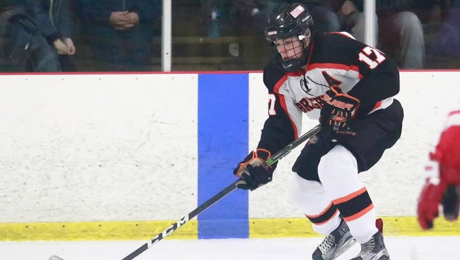 Adam Conquest (17) scored twice for Brighton in its 7-2 victory over Salem on Friday night in the Cranbrook Thanksgiving Invitational