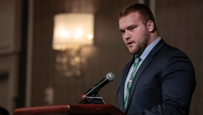 Michigan State University's Brian Allen speaks after receiving the Michael R. Sadler Award during the National Football Foundation State of Michigan Chapter awards banquet at the Dearborn Inn in Dearborn on Dec. 10, 2017.