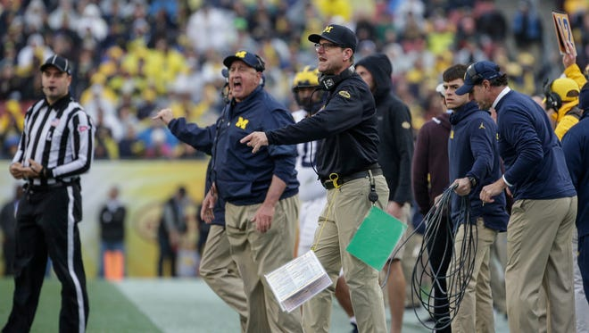 Jim Harbaugh reacts to a play in the Outback Bowl at Raymond James Stadium in Tampa, Fla., Jan. 1, 2018.
