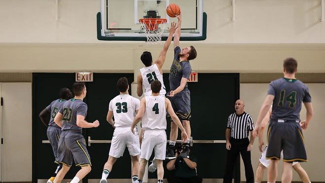 The University of Vermont's Nate Rohrer (44) goes in for a dunk on Wednesday at Dartmouth. The Catamounts resume America East play Saturday at home vs. Stony Brook.