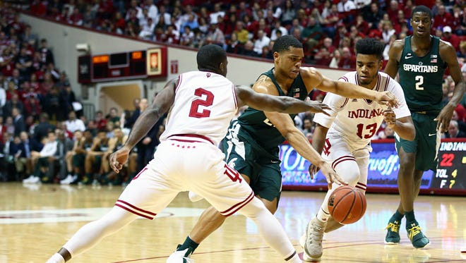 Michigan State Spartans guard Miles Bridges (22) drives to the basket against Indiana Hoosiers guard Josh Newkirk (2) and forward Juwan Morgan (13) in the first half at Assembly Hall, Saturday, Feb. 3, 2018.