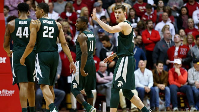 Michigan State Spartans guard Matt McQuaid (right) reacts to the bench after making a three point basket against the Indiana Hoosiers in the second half at Assembly Hall, Saturday, Feb. 18, 2018.