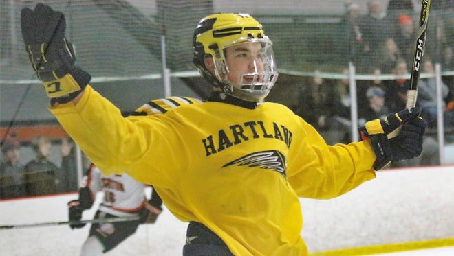 Hartland's Gabe Anderson celebrates his first-period goal in a 4-2 victory over Brighton on Monday, Feb. 12, 2018.