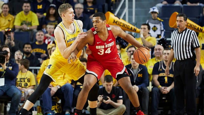 Ohio State forward Kaleb Wesson (34) is defended by Michigan forward Moritz Wagner (13) in the first half on Sunday, Feb. 18, 2018, at Crisler Center.