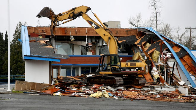 The former O'Brien Auto Group is torn down to become the future home of the Salem Police Facility at Division St. NE and Commercial St. NE in Salem on Friday, March 16, 2018.
