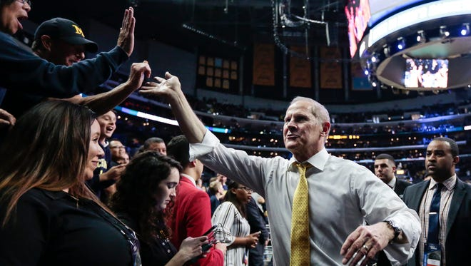 John Beilein high fives-fans as he walks off the court after Michigan crushed Texas A&M, 99-72, in the Sweet 16 of the NCAA tournament in Los Angeles on Thursday, March 22, 2018.