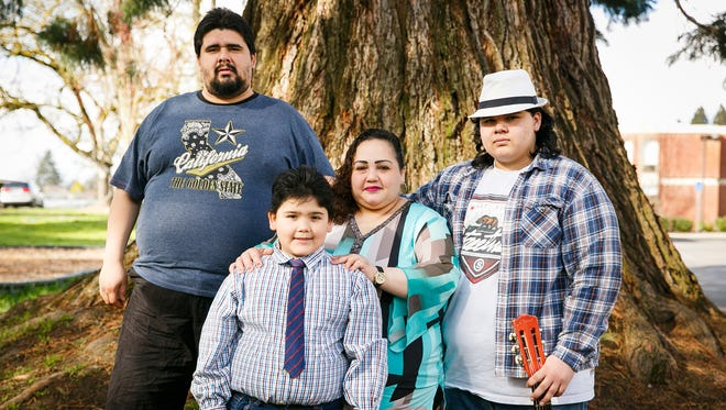 (Left to right) Oscar, Jimmy, Claudia and AJ Campos pose for a portrait on Friday, March 16, 2018. After becoming homeless in 2016, the Campos family worked through several living situations before landing at the St. Joseph Shelter in Mt. Angel