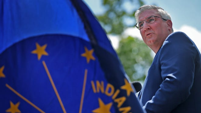Governor Eric Holcomb delivers the keynote address during the 150th Observance of Memorial Day at Crown Hill National Cemetery, Monday, May 28, 2018.
