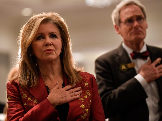 U.S. Senate candidate Marsha Blackburn sings the national anthem at the Williamson County Republican Party annual Reagan Day Dinner Friday, Feb. 23, 2018 in Franklin, Tenn.