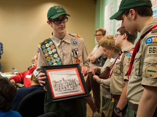 As part of his Eagle Scout project, Philadelphia Boy Scout Derek Copeland has volunteers interview military veterans and record their stories for the Library of Congress' Veterans History Project, December 28, 2014 in Philadelphia. Derek Copeland of Boy Scout Troop 665 walks around with WW II vet John Lauriello's photo of the surviving marines of his troop from the Battle of Imo Jima.