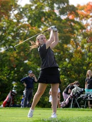 Sacred Heart Greenwich junior Caroline Dym tees off during the Sacred Heart Greenwich annual golf and tennis outing at Greenwich Country Club in Greenwich, Conn. Monday, Oct. 3, 2016.