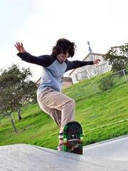 Adrian Cornejo, 18, on his board at Natividad Creek