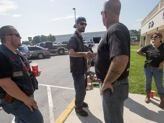 Matt MacGown, of York, second from left, came to bring the group water A group of friends are armed to defend the Armed Forces Career Center. The center is in the Manchester Crossroads shopping center along Route 30 in Manchester Township Monday July 20, 2015