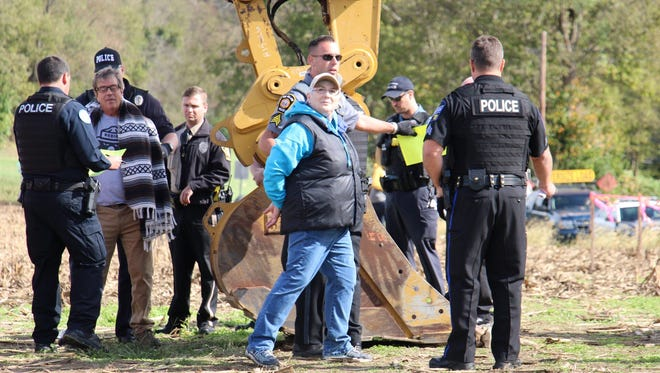 Police make arrests after a pipeline protest near Columbia, Lancaster County, on Monday.