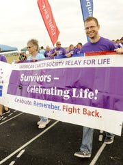 File - From left, Patsy Walesh, Sharon Wondrash and Zach Thorne lead the survivors lap at Two Rivers High School during the Relay for Life of Manitowoc County benefiting the American Cancer Society in 2014.