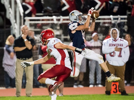 New Oxford's Owen Buhr (6) intercepts a pass intended