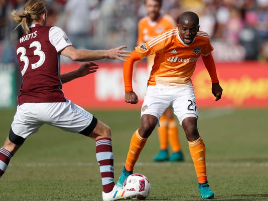 Colorado Rapids midfielder Jared Watts, left, defends against Houston Dynamo midfielder Boniek Garcia who moves the ball down the pitch in the first half of an MLS soccer match Sunday, Oct. 23, 2016, in Commerce City, Colo. (AP Photo/David Zalubowski)