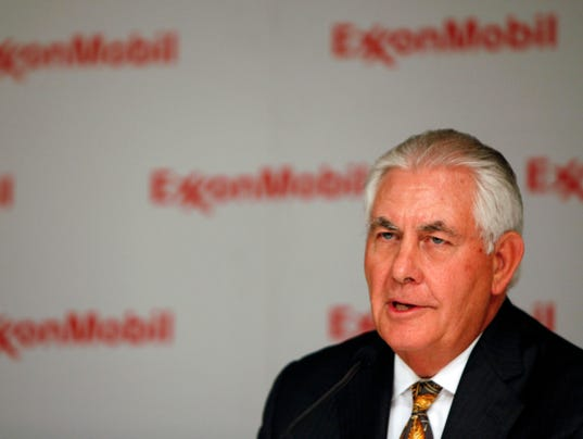 Rex Tillerson, chairman and chief executive of Exxon Mobil, speaks during a news conference in Dallas.