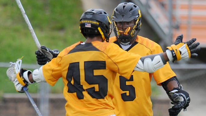 Moorestown's Frankie Labetti, 45, hugs Bryan Wright after scoring a goal earlier this season. Labetti and Wright were both Courier-Post All-South Jersey selections.