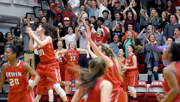 Erwin players and fans celebrate a buzzer-beater that