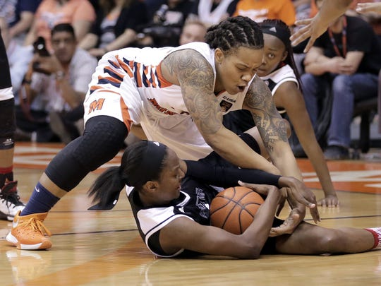 UTEP's Chrishauna Parker battles for a loose ball against