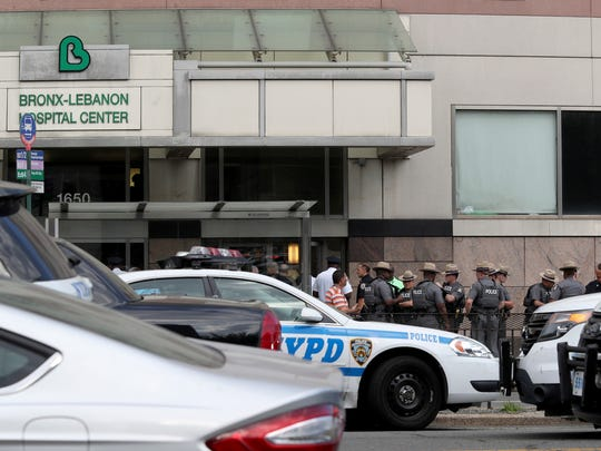 Police gather outside Bronx Lebanon Hospital in New