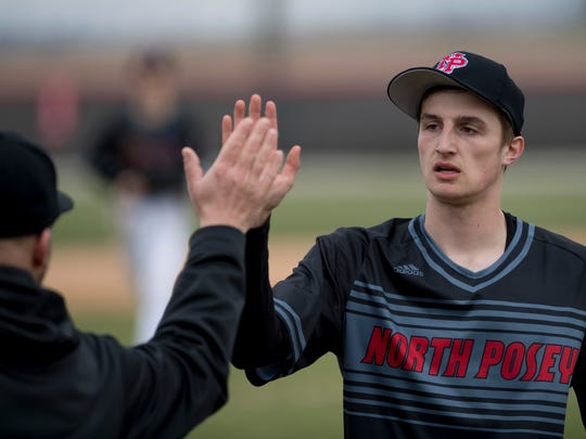 North Posey's Shane Harris (17) works out of the fifth inning against Carmi at North Posey High School Monday afternoon. North Posey got the win by beating Carmi 2-1.