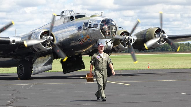 All four engines of this Boeing B-17 aircraft whirred to life Friday when it flew out of Marion Municipal Airport, among its passengers a World War II veteran who piloted a B-17.