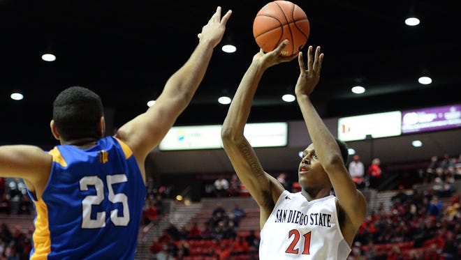 San Diego State's Malik Pope puts up a shot over San Jose Sate's Leon Bahner during a game last week in San Diego. The Aztecs are beginning to find their rhythm offensively heading into road games this week at CSU and Boise State.