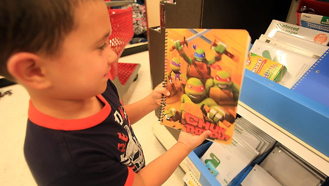 Cooper McGovern, 5, shows off his Teenage Mutant Ninja Turtles at Target in West Nyack on Friday.