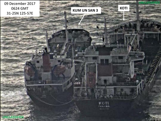 A North Korean vessel bearing a Chinese registration number exchanges cargo with a Panamanian-flagged vessel in this photo released by the U.S. Treasury Department as part of a crackdown on North Korean attempts to evade sanctions.