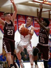 Owego's Christian Sage shows no near when he takes the ball to the basket.