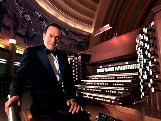 """Thomas Murray, a world master of the symphonic organ, sits at the keyboard of a Grand E. M. Skinner Concert Organ, the """"Cadillac"""" of American organs, that has been painstakingly installed at the Museum Center, Union Terminal."""