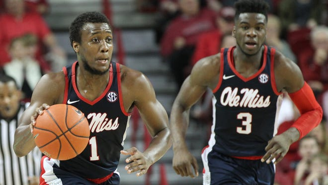 Ole Miss' Deandre Burnett (1) and Terence Davis (3) combined for 51 points, but the rest of the Rebels' starters scored 17 total points Saturday.