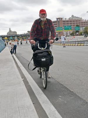 Thomas Salado of Collingswood rode his bike across Ben Franklin Bridge to get to Philadelphia to see Pope Francis on Sunday.    Sept. 27, 2015.